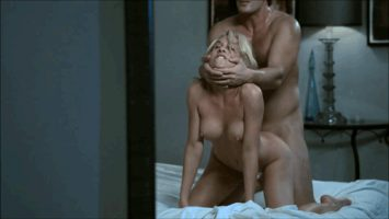 Blonde gettng rammed from behind doggy style while having neck lifted and choked by partner.