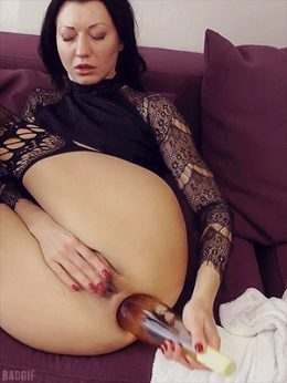 Hot Kinky Jo is using a wine bottle to prolapse her hole