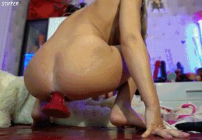 Massive dildo popping out of her hole