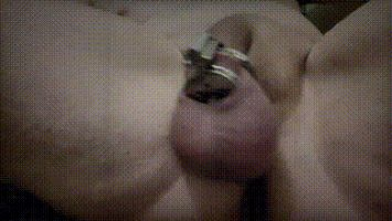 Sissy shows off gaping ass while cumming in cage
